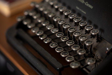 closeup of an old typewriter on wooden background