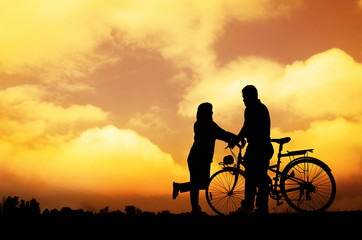 Silhouette of sweet couple in love happy time in beautiful sunset