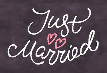 Just married. Chalkboard sign.
