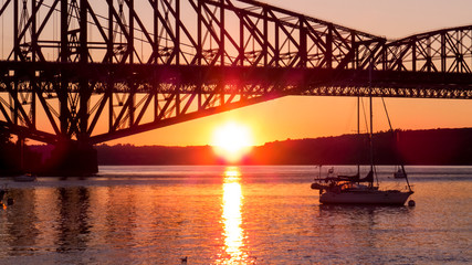 Canada - Sunset reflection over the water of a small marina near the old bridge between Levis and Quebec City.