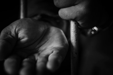 Business is a prisoner in his cell by a handcuffed prisoner
