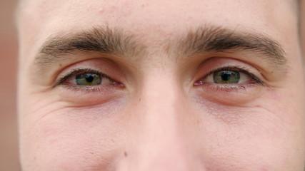 A close-up of a young man's eyes. Macro close-up shot