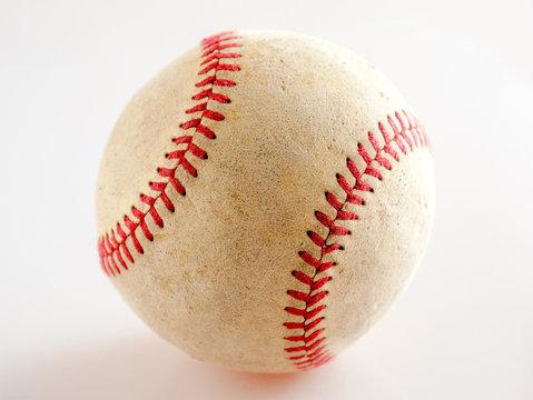 Sports Equipment old Baseball on white background