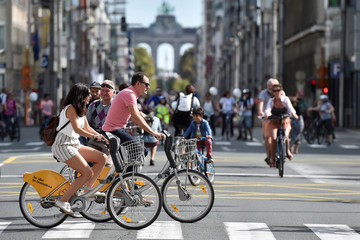 People ride their bicycles in the city centre of Brussels