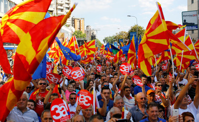 People hold placards reading ÔYes for European MacedoniaÕ during a march in support of a referendum on changing the country's name in Skopje