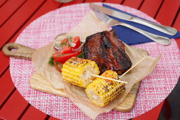Grilled corn and smoked pork ribs