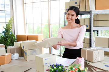 Woman filed a product package envelope paper in concept of sme,e - commerce business.