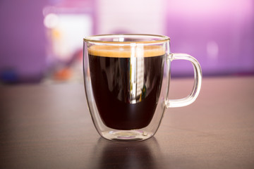 Cup of black coffee on the table