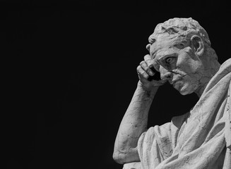 Man statue in the act of thinking. Ancient Roman Julian the Jurist statue made at the end of 19th century in front of the Old Palace of Justice in Rome (Black and White with copy space)