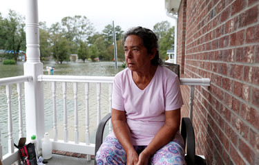 Willie Allen watches water rise from her porch during Tropical Storm Florence in Lumberton