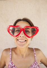 Girl with glasses in the shape of heart.