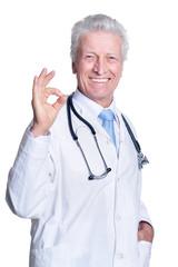 senior male doctor posing on white background