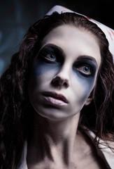 Close-up portrait of strange gloomy nurse (doctor)