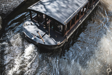 Top view of boat gondola ship for tourism on river.   through canal waters of Venice Italy. service of travel in city and making excursion for tourists , boad trips canal-boat. Free copyspace input
