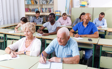 Elderly man and woman take a written exam