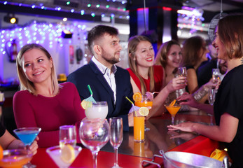 Girl with friends partying in bar