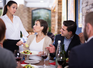 Angry couple conflict with waitress