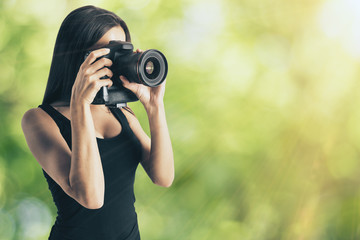 Attractive female taking photo