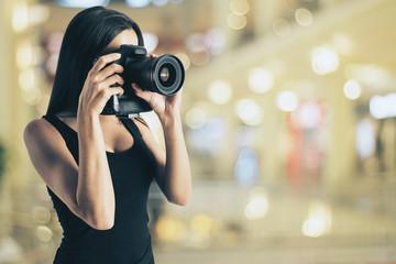 Attractive girl taking photo