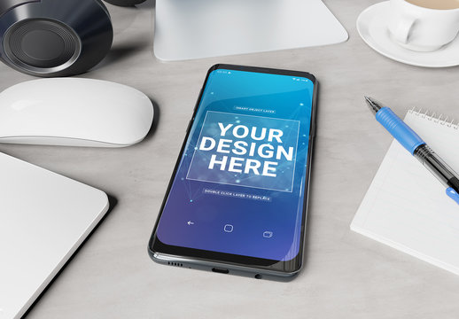 Smartphone Laying on a Desk Mockup
