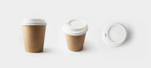 Blank take away kraft paper coffee cups with caps.
