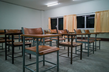 University classroom with many wooden chairs