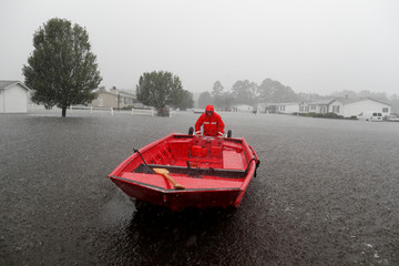 U.S. Coast Guard Petty Officer Don Tantanella patrols a neighborhood during Tropical Storm Florence in Lumberton
