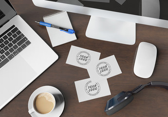 Three Business Cards on Wooden Desk Mockup
