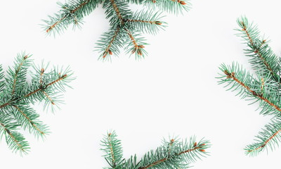 Christmas composition. Frame made of fir branches on white background. Flat lay, top view, copy space.