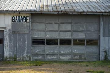 Abandoned Blue Garage Building Hand Written Sign