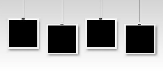 Four photo frames hanging on a clip. Vector