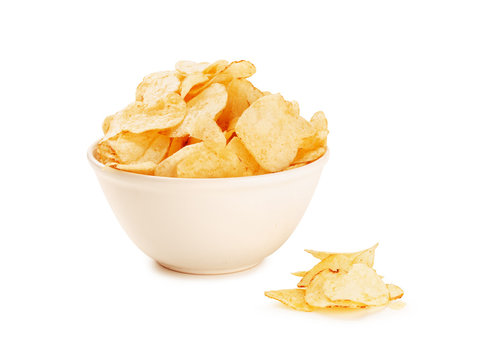 Bowl of home made potato chips on a white background