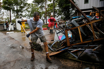 People clean their house after Hurricane Florence in New Bern