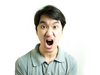 Young asian man yelling on white background