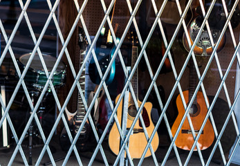 Foto op Plexiglas Muziekwinkel Pawn shop window covered by bars