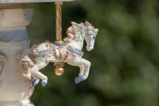 Close-up mini horse carousel, blurred background, cute, tiny, china.
