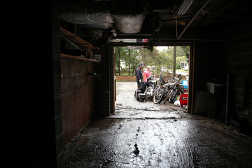 People clean their house after Hurricane Florence in New Bern, North Carolina