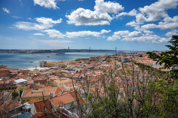 25th april bridge, Tagus river with ship and Lisbon
