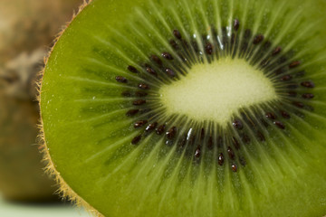 Beautiful and Juicy Green Kiwi slice, close up and focus on the heart