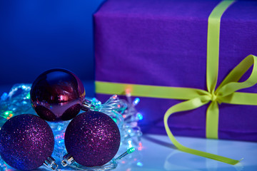 Beautiful purple Christmas box with decorations