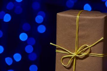 Simple craft Christmas box with bokeh lights