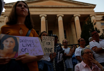 Family members of assassinated anti-corruption journalist Daphne Caruana Galizia attend a vigil to mark eleven months since her murder in a car bomb, in Valletta