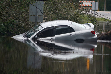 Partially submerged car is pictured on flooded street after Hurricane Florence struck Piney Green