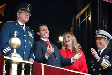 Mexico's President Enrique Pena Nieto, first lady Angelica Rivera, Defense Minister General Cienfuegos and Secretary of the Navy Admiral Soberon react during a military parade to celebrate Independence Day in Mexico City