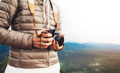 photographer traveler on mountain, tourist holding in hands digital photo camera closeup, hiker taking click photography, girl enjoy nature panoramic landscape in trip, relax holiday hobby concept