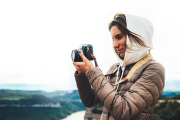 photographer traveler on green top on mountain, tourist looking enjoy nature panoramic landscape in trip, girl holding in hands digital photo camera, hiker taking click photography, holiday hobby