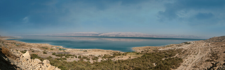 Panoramic landscape of Dead Sea and Jordan mountains in middle day