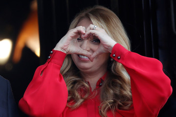 First lady Angelica Rivera makes a hand heart gesture during a military parade to celebrate Independence Day at Zocalo Square in Mexico City