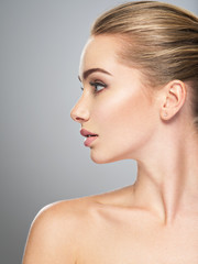 Profile face of  young  woman, skin care treatment.