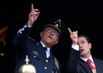Mexico's President Enrique Pena Nieto and Defense Minister General Salvador Cienfuegos gesture during a military parade to celebrate Independence Day in Mexico City